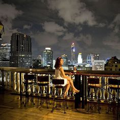 Pin for Later: 14 of the Most Romantic Date Ideas Ever Cheers at a Rooftop Bar