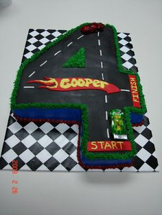 #4 Hot Wheels Birthday Cake - Chocolate Sour Cream Cake iced in BC with MMF track, log and stripes