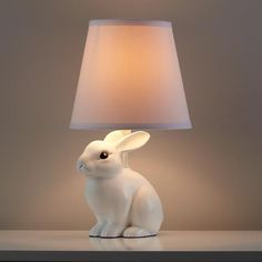 Adorable and super easy DIY project for your kid's room and even Easter decor: white rabbit base table lamp. Find more DIY lamp inspiration, tutorials and supplies at www.ilikethatlamp.com