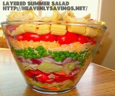 9 Layered Summer Salad Recipe ~ This salad always turns out amazing! It is very simple and looks stunning! It will be the perfect addition to any pot lucks you might be attending this summer!
