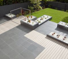 Our Belgian Limestone Midnight tiles complement that decking perfectly, don't you think?