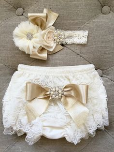 A personal favorite from my shop . https://www.thebabybellaboutique.com/collections/diapers-covers/products/ivory-and-gold-lace-ruffled-baby-bloomers-and-headband-set-headband-and-bloomers-newborn-outfit
