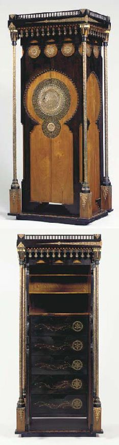 APPLIED AND INLAID EBONIZED WOOD CABINET, CARLO BUGATTI, circa 1902, applied with strips and roundels of beaten copper, inlaid with pewter and bone, doors opening to reveal three open shelves above five decorated drawers, with key, 79¾ in. (202.5 cm.) high, 34½ in. (87.6 cm.) wide, 25½ in. (64.8 cm.) deep  |  SOLD $59,750 Christie's New York, June 15, 2004