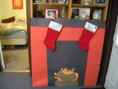 DIY fireplace for the college apartment made out of posterboard, cardboard boxes, and construction paper