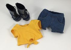 Lea is ready for just hanging out with this comfy and casual outfit. The knit bright yellow T-Shirt has short sleeves. The front has an adorable opening at the center front that ties. It closes in the back with Velcro. Her denim jean shorts have 2 front pockets and 2 back pockets. All seams have been top-stitched with the blue jean gold thread. There is elastic in the waist. The hem has the cut-off look which makes for a trendy look. Her denim boots lace up...but thats just for accent as…