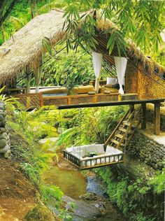 Resort Spa Treehouse, Bali. Imagine a tropical 5-star villa nestled in trees over a river gorge. This paradise resort is constructed all from natural materials. Included is an infinity swimming pool, culinary meals and the added comfort of a spa offering massages and healing treatments. #TakeMeToBali #Ubud
