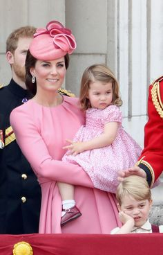 Catherine, Duchess of Cambridge, Princess Charlotte of Cambridge and Prince George of Cambridge look out from the balcony of Buckingham Palace during the Trooping the Colour parade on June 17, 2017 in London.
