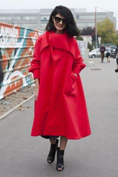 Channeling Little Red Riding Hood at Paris Fashion Week Spring 2014. Brights in street style