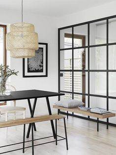 Modern dining space with all natural accents and a large IKEA pendant light