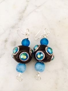 Once again, using two dazzling Jesse James beads to create a pair of striking earrings