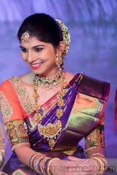 South Indian bride. Temple jewelry. Jhumkis.Purple silk kanchipuram sari with contrast blouse.Braid with fresh flowers. Tamil bride. Telugu bride. Kannada bride. Hindu bride. Malayalee bride.