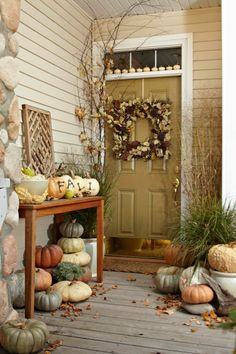 I love the mix of pumpkins used on this porch!