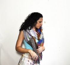Be soft with your voice and bold with your accessories. Scarf by Amber Kane