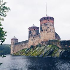 One of the most dramatic castles you ever did see Olavinlinna sits on a rocky island between two lakes. The fortress dates from the late when it first protected the former Kingdom of Sweden from Russia and then later protected Russia from Sweden. Kingdom Of Sweden, Lonely Planet, Tower Bridge, Lakes, Finland, Castles, Travel Photos, Travel Inspiration, Travel Destinations