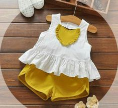 Dream closet (summer) for your princess is ready👸👑👚 white top with mustard yellow colour short perfect for summers .🌞🌼🌞 come fast and grab in any desire colour you want at Dukaan Girls Dresses Sewing, Dresses Kids Girl, Kids Outfits, Baby Dress Design, Baby Girl Dress Patterns, Baby Girl Fashion, Kids Fashion, Baby Frocks Designs, Toddler Girl