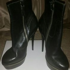 Luichiny Black Leather Ankle Boot w/zipper detail Black leather ankle boot...heel height aaprox. 5 inches...platform heel with zipper detail.  New, never worn.  Also available in grey suede. Luichiny Shoes Heeled Boots