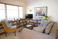 Low bookcases: Planks and cinderblocks from Home Depot (the blocks are covered with fabric). Brilliant.