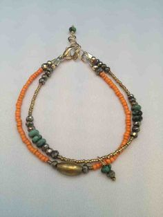 Relics Arm Candy in orange now online!!
