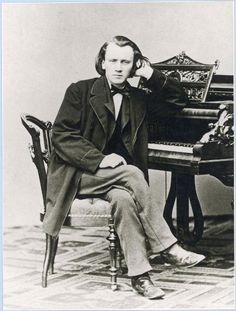 A young Johannes Brahms at the piano.