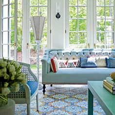 light blue tufted sofa, patterned tiles from Morocco