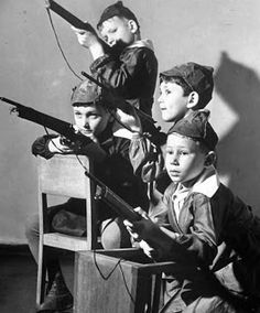 Margaret Bourke-White Moscow 1941 Russian kindergarten boys clad in miniature caps w. red stars, aiming toy rifles, barricaded behind classroom furniture, while playing war game. Moscow University, Virtual Memory, Margaret Bourke White, City People, Kids Sleep, Soviet Union, World War Two, First World, Wwii