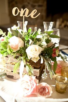Rustic Chic wedding centerpiece - gold and floral. Dawn Joseph Photography