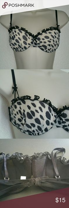 Victoria's Secret 34B Bra Very Sexy Victoria's Secret balconet bra is gently lined. Cute wildcat spots with ruffle at the top or the cups. Black and off-white. Victoria's Secret Intimates & Sleepwear Bras