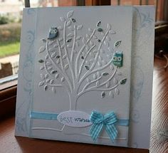 The embossed tree panel I posted the other day I've not put on to a card. I stamped some swirls down the sides and raised the panel off the card on 3d foam pads. I finished it off with a Craftwork Cards oval and a pretty ribbon and bow.