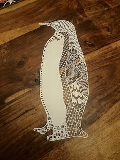 Welcome to my Etsy shop. This listing is for a jpeg image of a paper cut template called Zentangle penguin. This is for the digital file only for you to print out on your favorite paper, cut away the dark areas and infill if you wish. This template is for personal use only - You