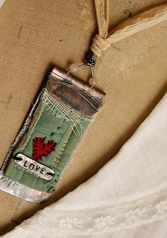 Art Quilt pendant by Rebecca Sower, via Flickr