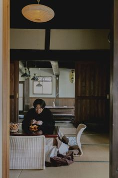 """The kotatsu, a low table with a heavy blanket, is a traditional Japanese home feature. """"During the colder winter months, the kotatsu, which has a heating element underneath, becomes an important part of our daily life – a place to eat, drink, play and rest,"""" says Ryo Kashiwazaki. """"I like older architecture, which drives my imagination to wonder why these buildings were made in such ways."""" Traditional House, Traditional Japanese, Japanese Countryside, Floor Seating, Spirited Away, Architecture Old, Japanese House, Interior Design Inspiration, Home Organization"""