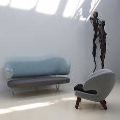 Finn Juhl FJ5000 sofa and Pelican chair.   Click the pic to see more of this amazing designer.