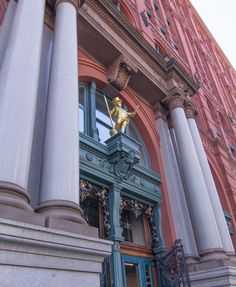 The Puck Building, on Lafayette Street, built in 1886, sports a gilded statue by sculptor Henry Baerer of Shakespeare's character Puck, from A Midsummer's Night Dream, (08/24/2016)