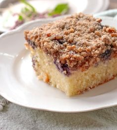 Blueberry Cream Cheese Coffee Cake has three layers to it. The cake layer on the bottom is sprinkled with blueberries and topped with a cream cheese filling. A crumb topping is sprinkled over the cream cheese filling to make 3 delicious layers.