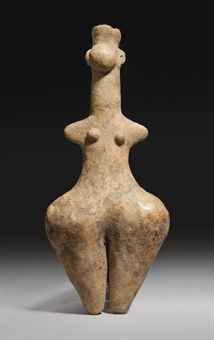 AN AMLASH TERRACOTTA STEATOPYGOUS FEMALE FIGURE, IRAN, CIRCA EARLY 1ST MILLENNIUM B.C.