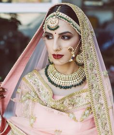 Looking for Bride posing in light pink lehenga and contrasting green jewellery? Browse of latest bridal photos, lehenga & jewelry designs, decor ideas, etc. on WedMeGood Gallery. Sikh Bride, Punjabi Bride, Pakistani Bridal, Bridal Lehenga, Punjabi Wedding, Desi Bride, Desi Wedding, Wedding Wear, Wedding Bride