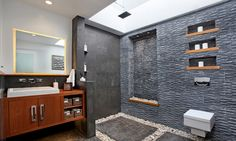 If there's one room in the home that takes the best advantage of stone's imperviousness to moisture, it's the bathroom. From limestone showers, to pebbled shower floors, to slate sinks, to marble countertops, stone is easy to clean, resistant to wear, and in many cases, highly resistant to staining. Stones used for bathroom applications must be pretreated to prevent damage from bath products, cleaning products, and water, and must be resealed regularly. If maintained properly, natural stone…