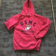 """United States Marine Corps"" sweatshirt Size medium United States Marine Corps's official sweatshirt, oh so soft and warm, heavyweight size medium, Hood and kangaroo pocket in front. No markings on back. No stains tears or rips's and a non-smoking house. Just bought this last Christmas wore it while my grandson was home from deployment, and I haven't had it on since  and now he's out of the Marines. Tops Sweatshirts & Hoodies"