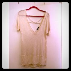 Urban Outfitters Cream Braided Back Top This oversize braided back top pairs perfectly with skinny jeans or leather leggings. Size XS, excellent condition. Urban Outfitters Tops Tunics