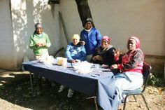 Beading Community in NW Province making qhubeka CYCLE FORCE bracelets. The beaded bracelets not only support an NGO, but local employment too.  www.beadcoalition.com