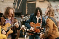 December 1969, San Diego-- David Crosby, Neil Young, and Stephen Stills. Crosby, Stills, and Nash were formed in the late sixties from members of The Hollies, The Byrds, and Buffalo Springfield. CSN collaborated with Neil Young occasionally, and racked up many hits in the 60s & 70s.