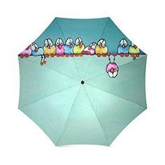 Paraguas con pájaros de colores