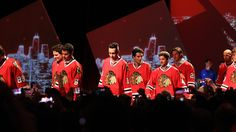 Blackhawks players walk down the red carpet at the 2017 Blackhawks Convention.