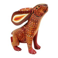 Beautiful rabbit by Master Carver David Hernandez.David creates some of the most beautiful wood carvings in Oaxaca, always impressively painted. I love the warm earth tones he chose for this wonderful rabbit.