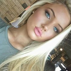 Gorgeous but would look better if she'd take those painted on lips off