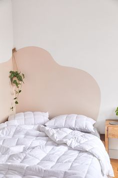 Urban Outfitters Home Now Sells Backdrop Paint - - Urban Outfitters Home dropped a new campaign with paint company Backdrop and the editorial spread features a genius faux headboard hack. Pink Headboard, Faux Headboard, Painted Headboards, Headboard Decor, Decor Room, Bedroom Decor, Bedroom Curtains, Bedroom Furniture, Bedroom Ideas