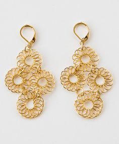 Blossomed Earrings - 14 karat gold plated blooms dangle from your ears for a glittering effect.