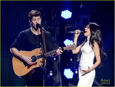 Shawn Mendes & Camila Cabello Cover Justin Bieber's 'Sorry' With Charlie Puth: Photo #900362. Shawn Mendes welcomes Camila Cabello onto the stage with a warm smile during 106.1 KISS FM's Jingle Ball 2015 held at American Airlines Center on Tuesday night…