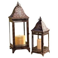 """Illuminate your front doorstep with this eye-catching design, perfect for welcoming guests or enjoying summer evenings on the porch.   Product: Small and large lanternConstruction Material: Metal and glassColor: BrownDimensions: 26"""" H x 9.5"""" W x 9.5"""" D (large)Note: Candles not included"""