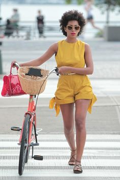 Solange Knowles's Azzedine Alaïa Studded Suede Flat Sandals and a bike with a basket!